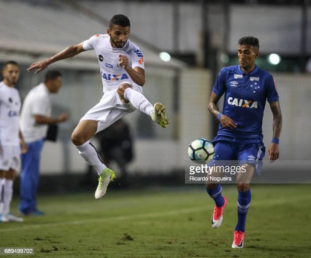 Thiago Maia of Santos battles for the ball with Rafael Marques of Cruzeiro during the match between Santos and Cruzeiro as a part of Campeonato...