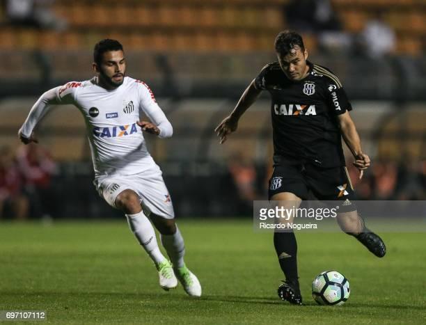 Thiago Maia of Santos battles for the ball with Renato Caja of Ponte Preta during the match between Santos and Ponte Preta as a part of Campeonato...