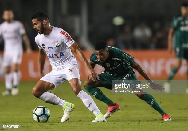 Thiago Maia of Santos battles for the ball with Tche Tche of Palmeiras during a match between Santos and Palmeiras as a part of Campeonato Brasileiro...