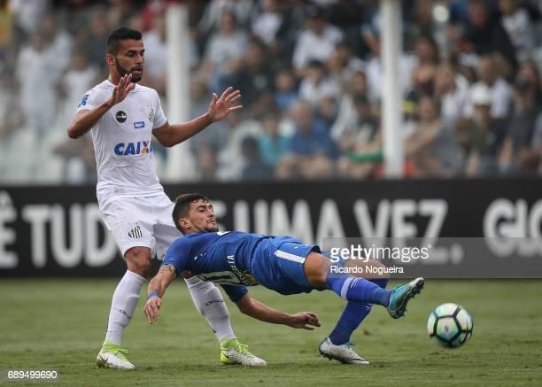 Thiago Maia of Santos on the ball with De Arrascaeta of Cruzeiro during the match between Santos and Cruzeiro as a part of Campeonato Brasileiro 2017...