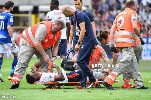 Thiago Mendes of Lille goes out injured during the Ligue 1 match between Racing Club Strasbourg and Lille OSC at Stade de la Meinau on August 13 2017...