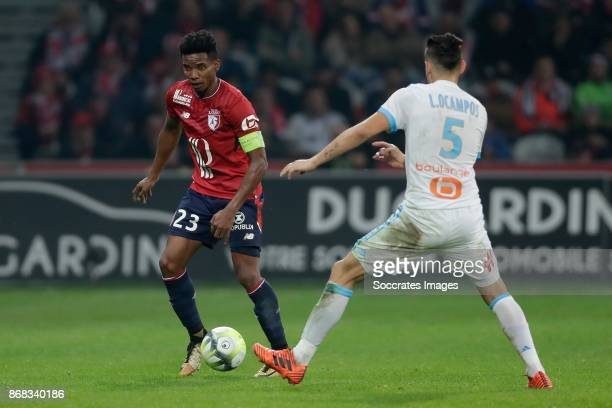 Thiago Mendes of Lille Lucas Ocampos of Olympique Marseille during the French League 1 match between Lille v Olympique Marseille at the Stade Pierre...