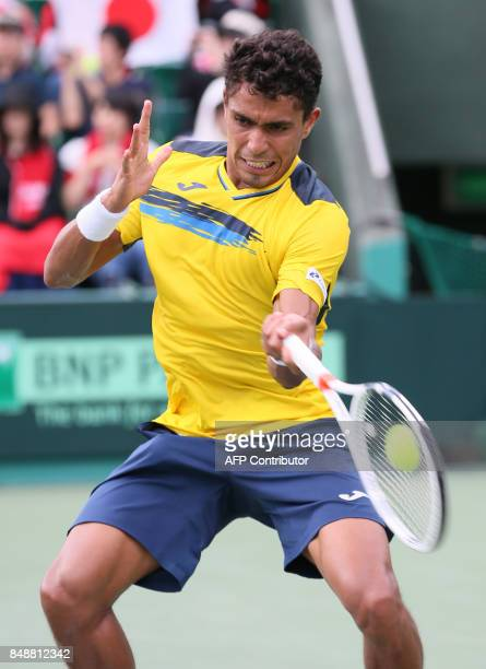 Thiago Monteiro of Brazil hits a return to Yuichi Sugita of Japan of the Davis Cup World Group playoff between Japan and Brazil in Osaka western...