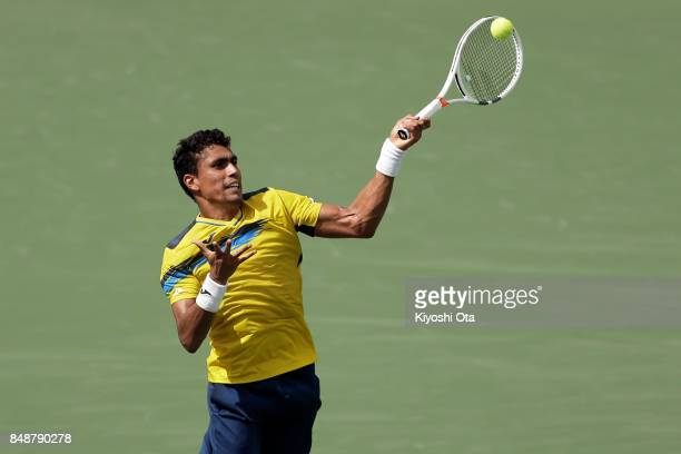 Thiago Monteiro of Brazil plays a forehand in his singles match against Yuichi Sugita of Japan during day four of the Davis Cup World Group Playoff...