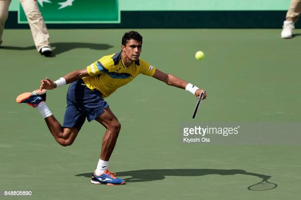 Thiago Monteiro of Brazil plays in his singles match against Yuichi Sugita of Japan during day four of the Davis Cup World Group Playoff between...