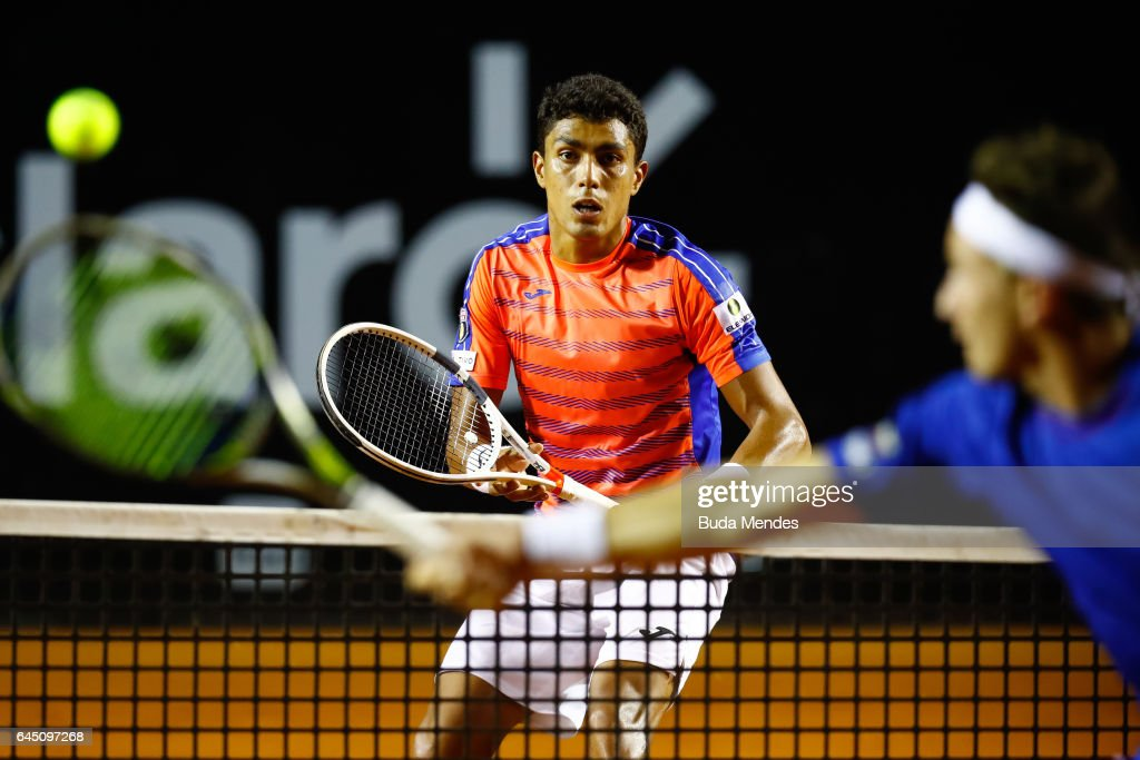 Thiago Monteiro of Brazil returns a shot to Casper Ruud of Norway during the quarter finals of the ATP Rio Open 2017 at Jockey Club Brasileiro on February 24, 2017 in Rio de Janeiro, Brazil.