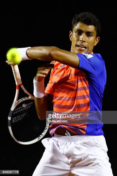 Thiago Monteiro of Brazil returns a shot to Casper Ruud of Norway during the quarter finals of the ATP Rio Open 2017 at Jockey Club Brasileiro on...