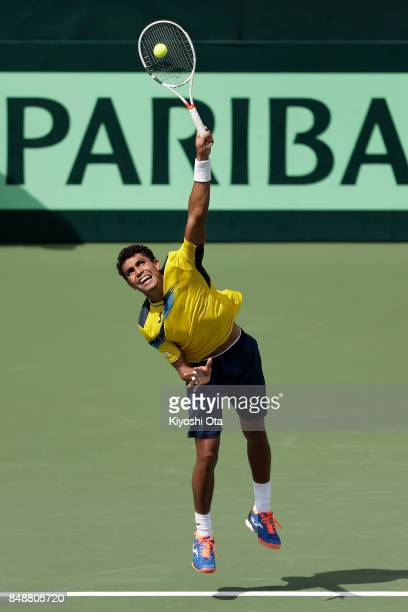 Thiago Monteiro of Brazil serves in his singles match against Yuichi Sugita of Japan during day four of the Davis Cup World Group Playoff between...