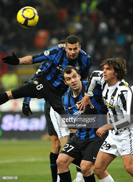 Thiago Motta and Goran Pandev of FC Inter Milan goes up for the ball against Paolo De Ceglie of Juventus FC during the Tim Cup match between FC Inter...