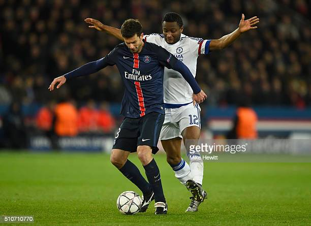 Thiago Motta of Paris SaintGermain evades John Mikel Obi of Chelsea during the UEFA Champions League round of 16 first leg match between Paris...