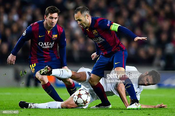 Thiago Motta of Paris SaintGermain FC competes for the ball with Lionel Messi and Andres Iniesta of FC Barcelona during the UEFA Champions League...