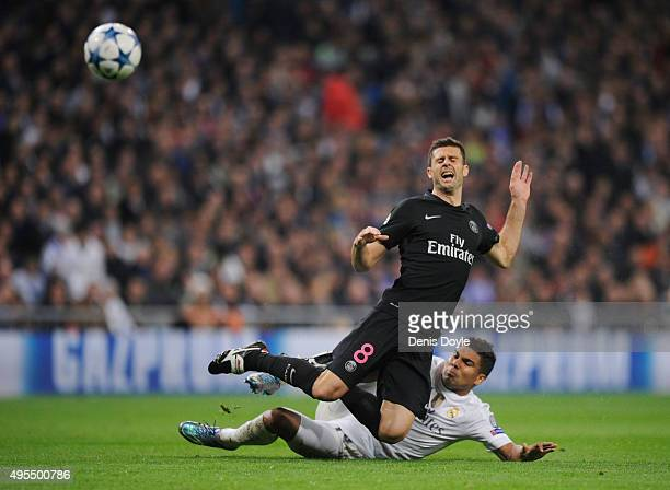 Thiago Motta of PSG is tackled by Casemiro of Real Madrid during the UEFA Champions League Group A match between Real Madrid CF and Paris...