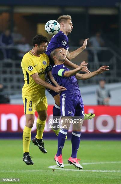 Thiago Motta of PSG Lukasz Teodorczyk and Sofiane Hanni of Anderlecht during the UEFA Champions League match between RSC Anderlecht and Paris Saint...
