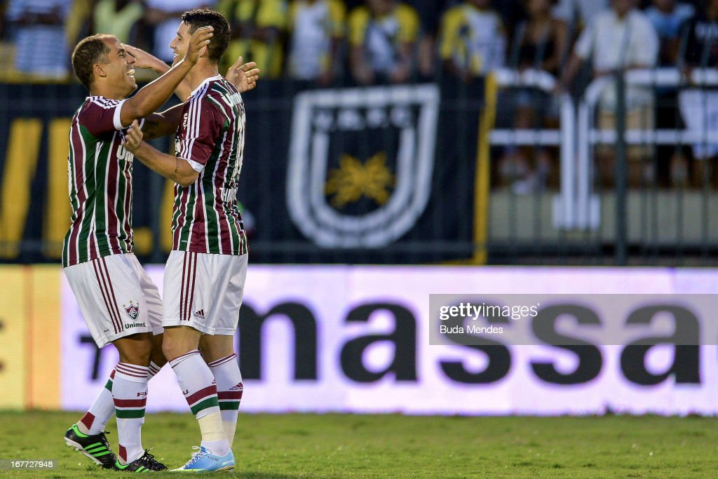 Thiago Neves and Felipe of Fluminense celebrate a scored goal during the match between Fluminense and Volta Redonda as part of Rio State Championship 2013 at Raulino de Oliveira Stadium on April 28, 2013 in Volta Redonda, Brazil.
