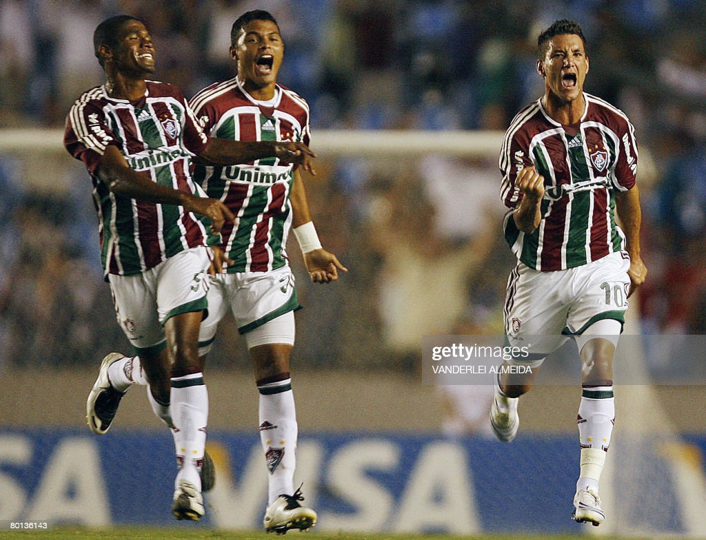 Thiago Neves Igor and Tiago Silva of Fluminense FC of Brazil celebrate after scoring against Arsenal of Argentina during their Libertadores Cup...