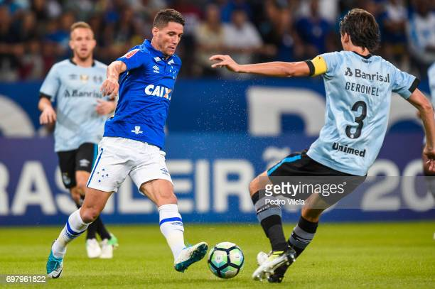 Thiago Neves of Cruzeiro and Pedro Geromel of Gremio battle for the ball during a match between Cruzeiro and Gremio as part of Brasileirao Series A...