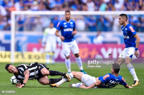 Thiago Neves of Cruzeiro and Valencia of Botafogo battle for the ball during a match between Cruzeiro and Botafogo as part of Brasileirao Series A...