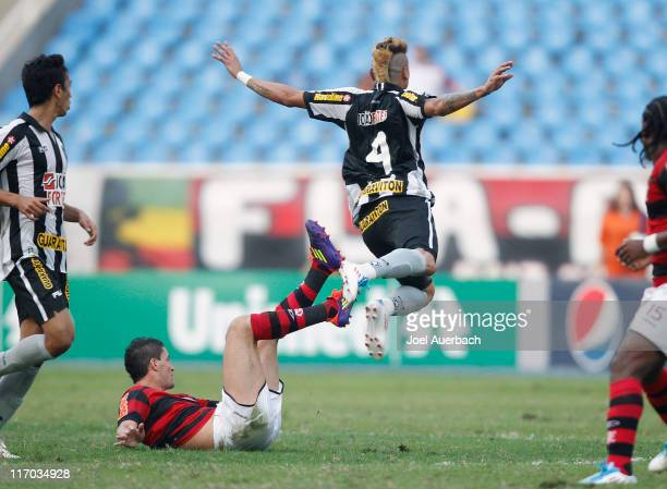 Thiago Neves of Flamengo trips Fabio Ferreira of Botafogo during a match as part of the Brazilian Championship 2011 at Engenhao Stadium on June 19...