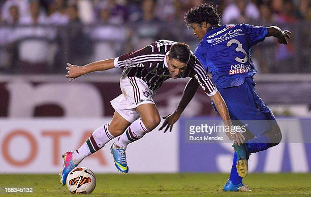 Thiago Neves of Fluminense fights for the ball with Jonh Narvaez of Emelec during the match between Fluminense and Emelec as part of Libertadores Cup...