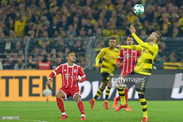 Thiago of Bayern Muenchen and Andrey Yarmolenko of Dortmund battle for the ball during the German Bundesliga match between Borussia Dortmund v Bayern...