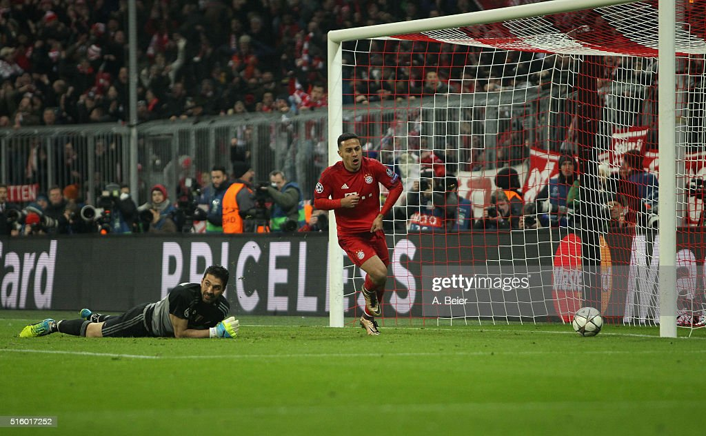 Thiago (R) of Bayern Muenchen celebrates his goal as goalkeeper <a gi-track='captionPersonalityLinkClicked' href=/galleries/search?phrase=Gianluigi+Buffon&family=editorial&specificpeople=208860 ng-click='$event.stopPropagation()'>Gianluigi Buffon</a> of Juventus Turin reacts during the Champions League round of 16 second leg match between FC Bayern Muenchen and Juventus Turin at Allianz Arena on March 16, 2016 in Munich, Germany.