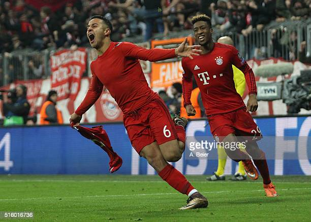 Thiago of Bayern Muenchen celebrates his goal together with his teammate Kingsley Coman during the Champions League round of 16 second leg match...
