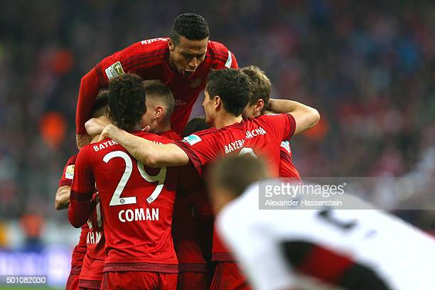 Thiago of Bayern Muenchen celebrates with his team mates the 2nd team goal whilst Robert Bauer of Ingolstadt reacts during the Bundesliga match...