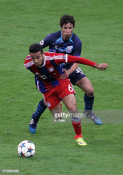 Thiago of Bayern Muenchen fights for the ball with Oliver Torres of FC Porto during the Champions League quarter final second leg match between FC...