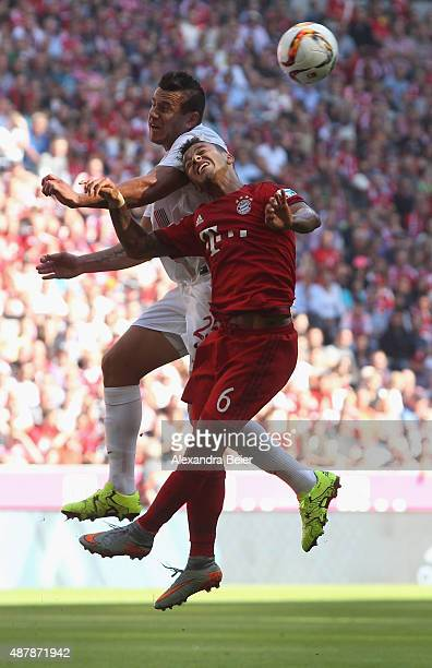 Thiago of Bayern Muenchen heads for the ball with Raul Bobadilla of FC Augsburg during the Bundesliga match between FC Bayern Muenchen and FC...