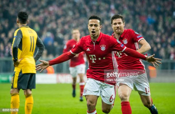 Thiago of Bayern Munich celebrates after the fourth goal during the UEFA Champions League Round of 16 first leg match between FC Bayern Muenchen and...