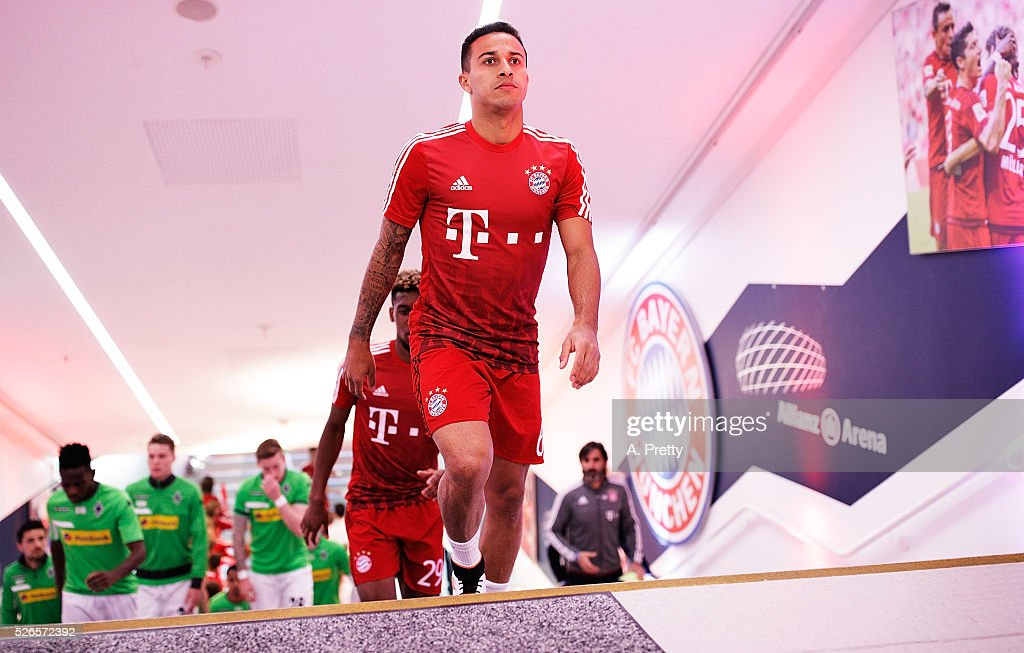 Thiago of Bayern Munich walks into the dressing rooms after warming up for the Bundesliga match between FC Bayern Muenchen and Borussia Moenchengladbach on April 30, 2016 in Munich, Bavaria.