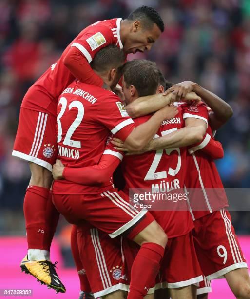 Thiago of FC Bayern Muenchen and teammates celebrate Robert Lewandowski's first goal during the Bundesliga match between FC Bayern Muenchen and 1 FSV...