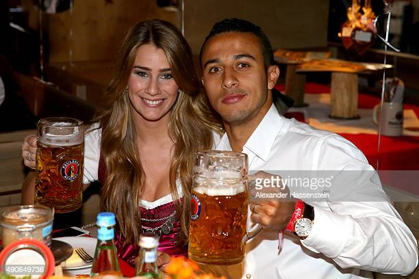 Thiago of FC Bayern Muenchen attends with Julia Vigas the Oktoberfest 2015 Beerfestival at Kaefer Wiesenschaenke at Theresienwiese on September 30...