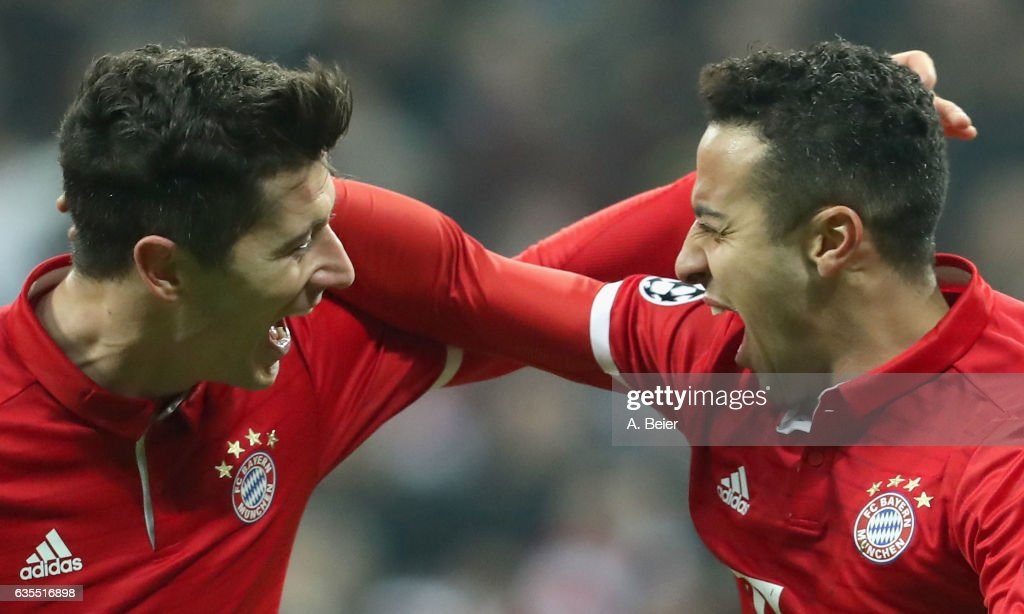 Thiago (R) of FC Bayern Muenchen celebrates his first goal with teammate Robert Lewandowski during the UEFA Champions League Round of 16 first leg match between FC Bayern Muenchen and Arsenal FC at Allianz Arena on February 15, 2017 in Munich, Germany.