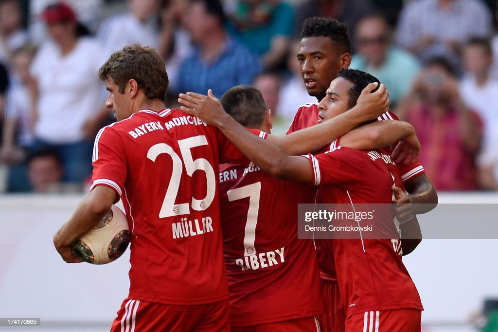 Thiago of FC Bayern Muenchen celebrates with teammates after scoring his team's third goal during the Telekom 2013 Cup final between FC Bayern...