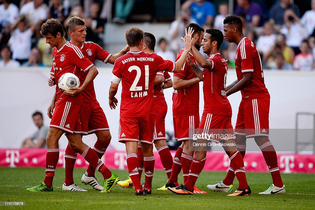Thiago of FC Bayern Muenchen celebrates with teammates after scoring his team's third goal during the Telekom 2013 Cup final between FC Bayern Muenchen and Borussia Moenchengladbach on July 21, 2013 in Moenchengladbach, Germany.