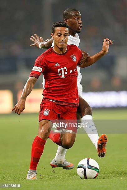 Thiago of FC Bayern Muenchen challenges Geoffry Kongdogbia of FC Internazionale during the international friendly match between FC Bayern Muenchen...