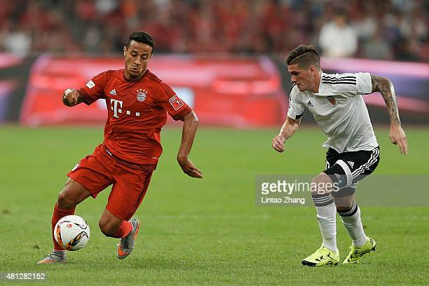 Thiago of FC Bayern Muenchen challenges with Rodrigo De Paul of Valencia FC during the international friendly match between FC Bayern Muenchen and...