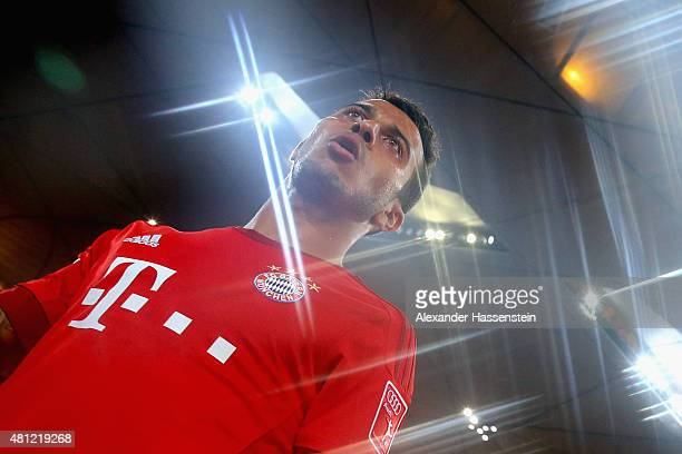 Thiago of FC Bayern Muenchen enters the field for the international friendly match between FC Bayern Muenchen and Valencia FC of the Audi Football...
