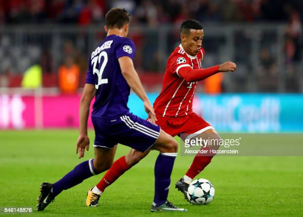 Thiago of Muenchen and Leander Dendoncker of Anderlecht battle for the ball during the UEFA Champions League group B match between Bayern Muenchen...