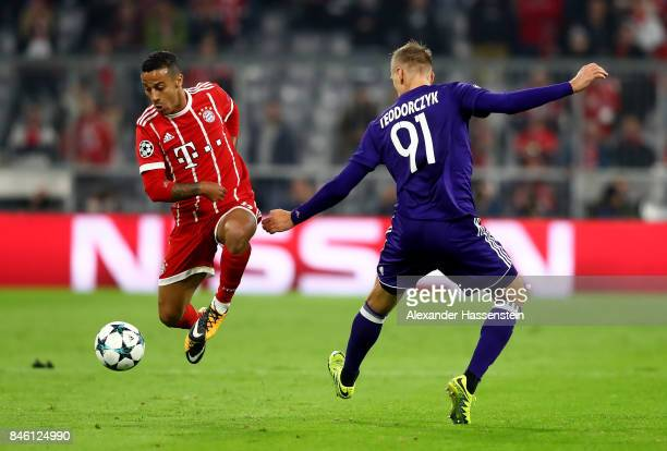 Thiago of Muenchen and Lukasz Teodorczyk of Anderlecht battle for the ball during the UEFA Champions League group B match between Bayern Muenchen and...