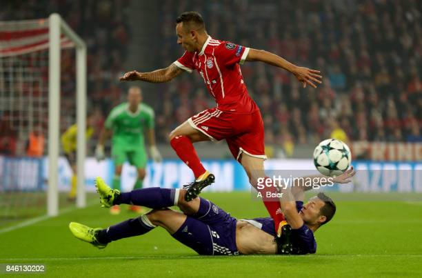 Thiago of Muenchen and Uro Spajic of Anderlecht battle for the ball during the UEFA Champions League group B match between Bayern Muenchen and RSC...