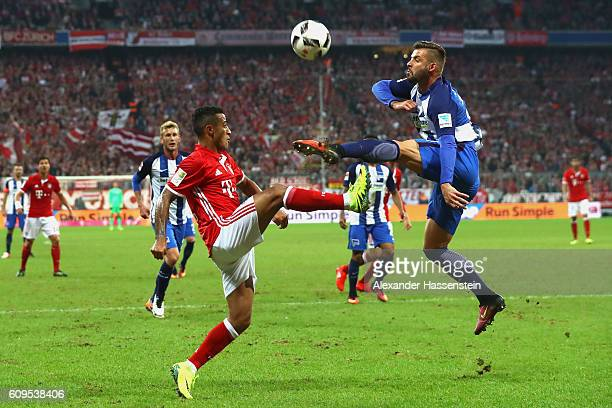 Thiago of Muenchen battles for the ball with Marvin Plattenhardt of Berlin during the Bundesliga match between Bayern Muenchen and Hertha BSC at...