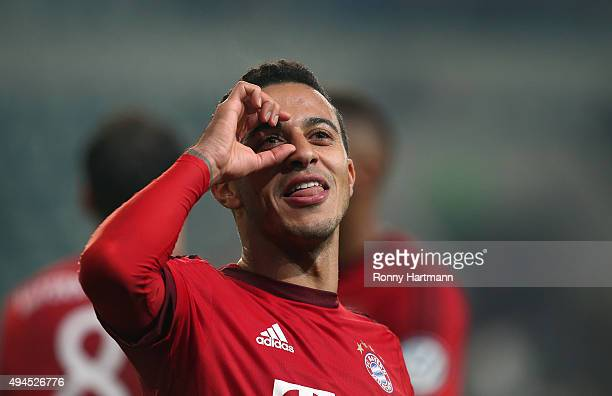 Thiago of Muenchen celebrates after the DFB Cup second round match between VfL Wolfsburg and FC Bayern Muenchen at Volkswagen Arena on October 27...