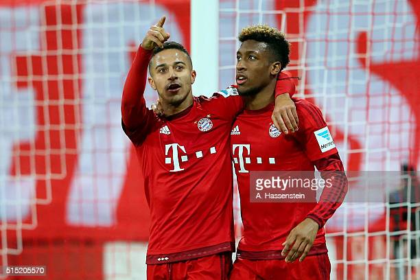 Thiago of Muenchen celebrates scoring the 5th team goal with his team mate Kingsley Coman during the Bundesliga match between FC Bayern Muenchen and...
