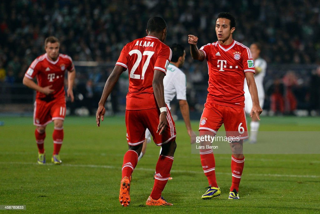 Thiago of Muenchen celebrates with David Alaba after scoring his teams second goal during the FIFA Club World Cup Final between FC Bayern Muenchen...