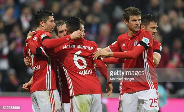 Thiago of Muenchen celebrates with his teammates after scoring his team's first goal during the Bundesliga match between Bayern Muenchen and Bayer 04...