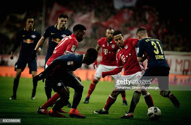 Thiago of Muenchen fights for the ball with Diego Demme of Leipzig during the Bundesliga match between Bayern Muenchen and RB Leipzig at Allianz...