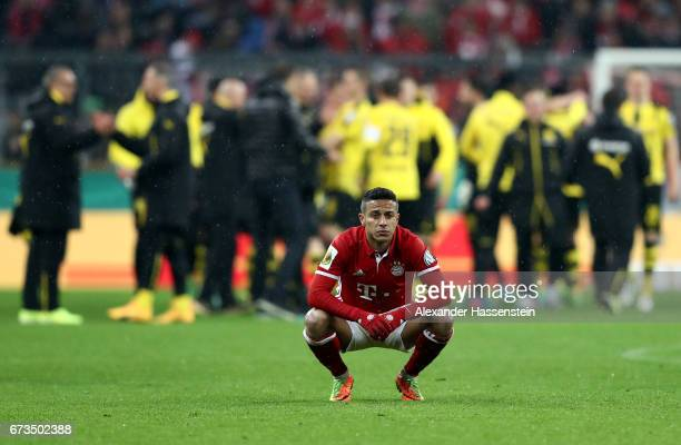 Thiago of Muenchen reacts during the DFB Cup semi final match between FC Bayern Muenchen and Borussia Dortmund at Allianz Arena on April 26 2017 in...