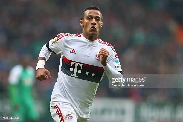 Thiago of Muenchen runs with the ball during the Bundesliga match between SV Werder Bremen and FC Bayern Muenchen at Weserstadion on October 17 2015...